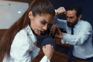 Young businessman and businesswoman compete