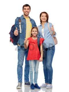 happy family with travel bags showing thumbs up