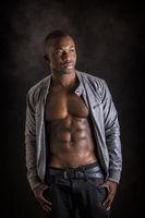 Shirtless muscular black young man in studio shot