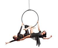 Young women doing gymnastic exercises on the hoop