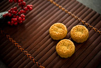 Mooncakes on bamboo mat low light