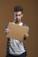 Young man holding a card board