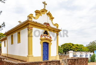 Facade of a historic church in colonial architecture with ancient cemetery behind