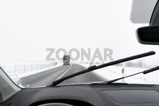 View from a car to road with snow