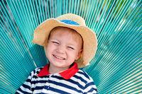 Toddler boy in beach chair