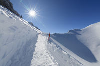 Path on Karwendelgrube Karwendel mountainrange with sun in winter