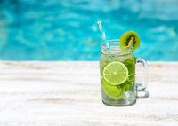 Homemade lemonade on wooden background