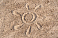 Simple sun drawing in the sand