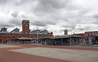 view of ashton open market with stalls and the historic market hall built in 1829