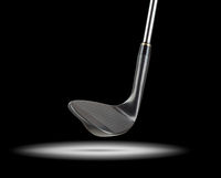 Black Golf Club Wedge Iron Under Spot Light With Black Background