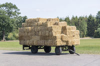 Plain old farm wagon with straw bales stacked