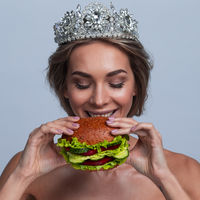 Woman in diadem with vegan burger