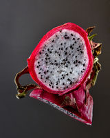 Exotic fruit Pitahaya isolated on a black glossy background
