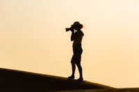 Silhouette of a photographer in the desert