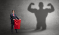 Businessman with strong hero shadow and toreador concept