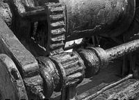 rusted cogs and gears on an old broken industrial machine