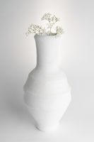 White pottery vase and small white flowers on white background