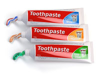 Tubes of toothpaste in different colors and differnt types of toothpaste