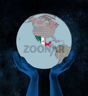 Mexico on political globe in hands