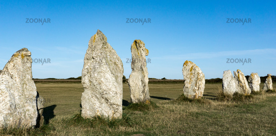 the standing stone alignments of Lagatjar in Brittany in soft morning light
