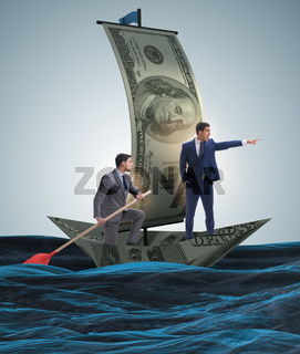 Business partnership with businessmen sailing on dollar boat