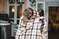 Three girlfriends on the veranda