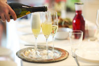 Champagne glasses and bottle in restaurant