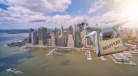 Drone flying with package over lower Manhatten, New York City
