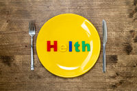 Word HEALTH on a plate