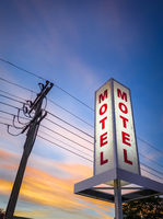 Vintage motel sign at sunset