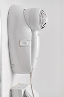 Hair dryer  over white wall