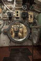 inside submarine opened round hatch