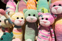 cute knitted toys knitted kitten sit together with other crochet toys on the weekend market.