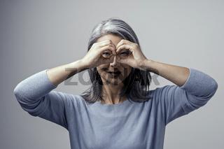 Beautiful Asian woman posing on grey background