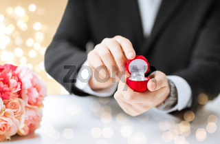 man with diamond engagement ring in red gift box