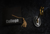 Key and college education graduation cap