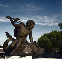 Straddling the fish whale (leviathan) a young man with a Trident. Ancient bronze sculpture