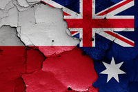 flags of Poland and Australia painted on cracked wall