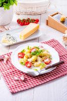 delicious gnocchi with gorgonzola cream sauce and cherry tomatoes