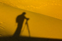 The shadow of a man in the sands of the desert