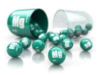 Capsule with magnesium Mg  element.  Dietary supplements. Vitamin capsule isolated on white.