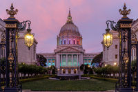 Twilight skies over San Francisco City Hall illuminated in rainbow colors for the Pride Parade.