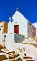 Greek orthodox church with greek flag