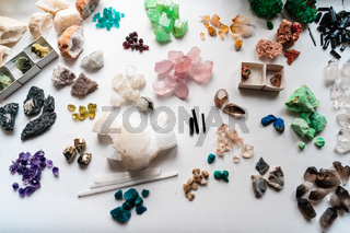 Collection of beautiful precious stones on white table.