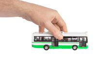 Hand with toy bus