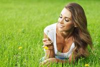 beautiful young woman with dandelion beautiful young woman with dandelion