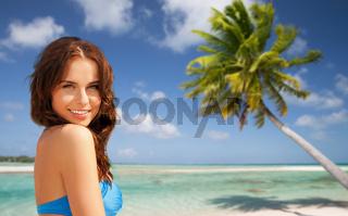 happy woman in bikini swimsuit on tropical beach