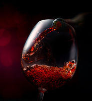 Wine on a red background
