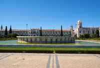 Empire Square with the fountain and  Jeronimos Monastery. Lisbon. Portugal