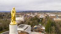 The Golden Woodcutter Oregon Pioneer atop Capital Building Salem